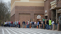 A line of residents stretches Friday, March 20, 2020, across the length of the store as they wait to enter the Sam's Club location before it opened in Fayetteville. Shoppers needing grocery items and supplies at area stores have been met with essential products being in short supply. Visit nwaonline.com/200321Daily/ for today's photo gallery.<br /> (NWA Democrat-Gazette/Andy Shupe)