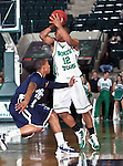 North Texas Mean Green guard Avery Redmond (12) gets ready to pass the ball in the game between the Jackson State Tigers and the University of North Texas Mean Green at the North Texas Coliseum,the Super Pit, in Denton, Texas. UNT defeated Jackson 68 to 49