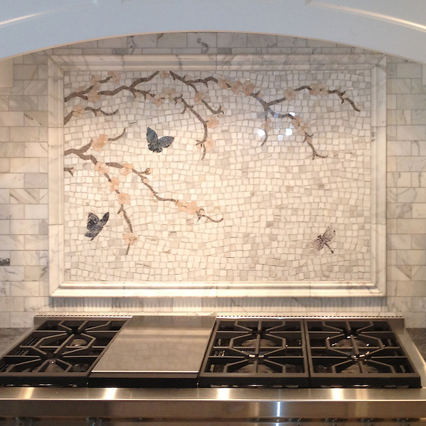 Custom Butterfly/Plum Blossom hand cut stone mosaic, shown in Calacatta Tia, Driftwood, Rosa Portagallo, Blue Bahia, Blue Macauba, and Lavender Mist.<br />