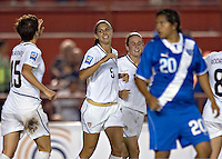 Alex Morgan (C) of USA celebrates a goal at the 2010 CONCACAF Women's World Cup Qualifying tournament held at Estadio Quintana Roo in Cancun, Mexico.