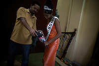Salam, 19 years old, winner of the Miss Obama beauty pageant held at the Obama Cafe In Amhara's regional capital Bahir Dar is shown pictures taken of her by a local photographer  on President Barack Obama's inauguration day, Tuesday January 20 2009..