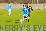 Valley Wanderers Sean Ward gets away from Tralee Celtic's Jamie Blake  in the  Division 2 B Tralee Celtic against Valley Wanderers match at Mounthawk Park on Sunday