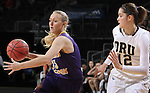 SIOUX FALLS, SD - MARCH 6:  Taylor McClintock #23 of Western Illinois drives past Dorottya Balla #12 of Oral Roberts in the 2016 Summit League Tournament. (Photo by Dick Carlson/Inertia)