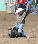 Ray Gomes throws up his hands in the 50-60 calf roping event.