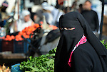 A woman in the market of the Nuseirat refugee camp in the middle of the Gaza strip. .