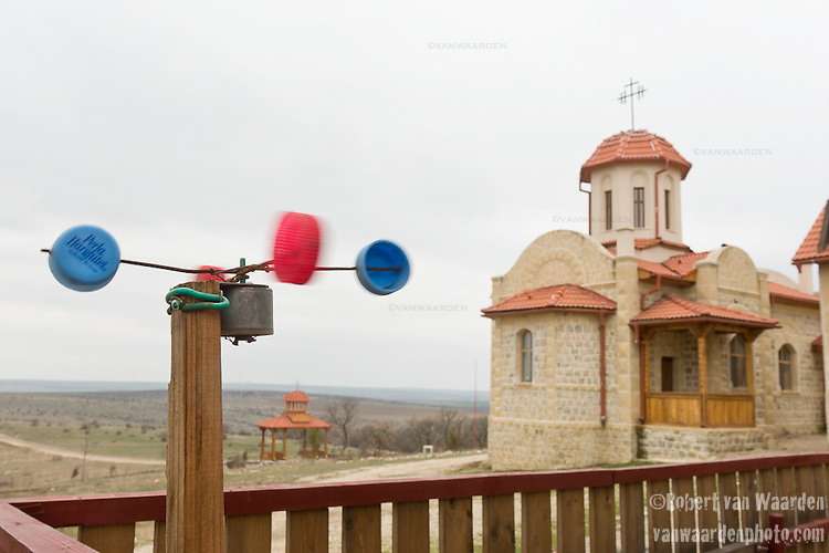 A childs wind toy spins in the wind at the Casian Monastery in Romania.