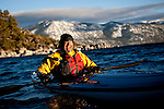 Chuck Freedman smiles after rolling his kayak on Lake Tahoe near Kings Beach, Calif., January 19, 2011.