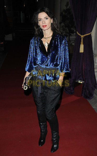 Lara Bohinc.The 'RA Now' VIP gala, Royal Academy of Arts, Burlington House, Piccadilly, London, England..October 8th, 2012.full length black blue velvet top belt trousers harem boots hand in pocket .CAP/CAN.©Can Nguyen/Capital Pictures.