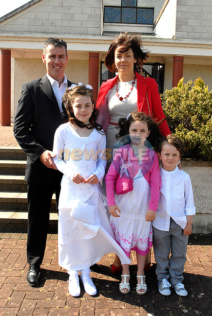 Allex Elliot who made her First Holy Communion at Mornington on Saturday pictured with her parents Sheena and Mark, sister Grace and brother Tom.