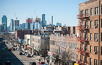 Development in Western Queens in New York blends into the Manhattan skyline with older buildings on Queens Boulevard in Sunnyside, Queens in the foreground on Sunday, March 5, 2017 (© Richard B. Levine)