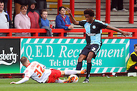 Tom Conlon of Stevenage and Sido Jombati of Wycombe Wanderers in action during the Sky Bet League 2 match between Stevenage and Wycombe Wanderers at the Lamex Stadium, Stevenage, England on 17 October 2015. Photo by PRiME Media Images.