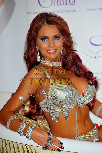 Amy Childs.launches new jewellery collection with Mikey London held at the Millennium May Fair Hotel London, England..October 24th, 2012.half length silver diamante bikini bra knickers underwear tub bathtub choker necklace jewelry bracelets chains cleavage.CAP/CJ.©Chris Joseph/Capital Pictures.