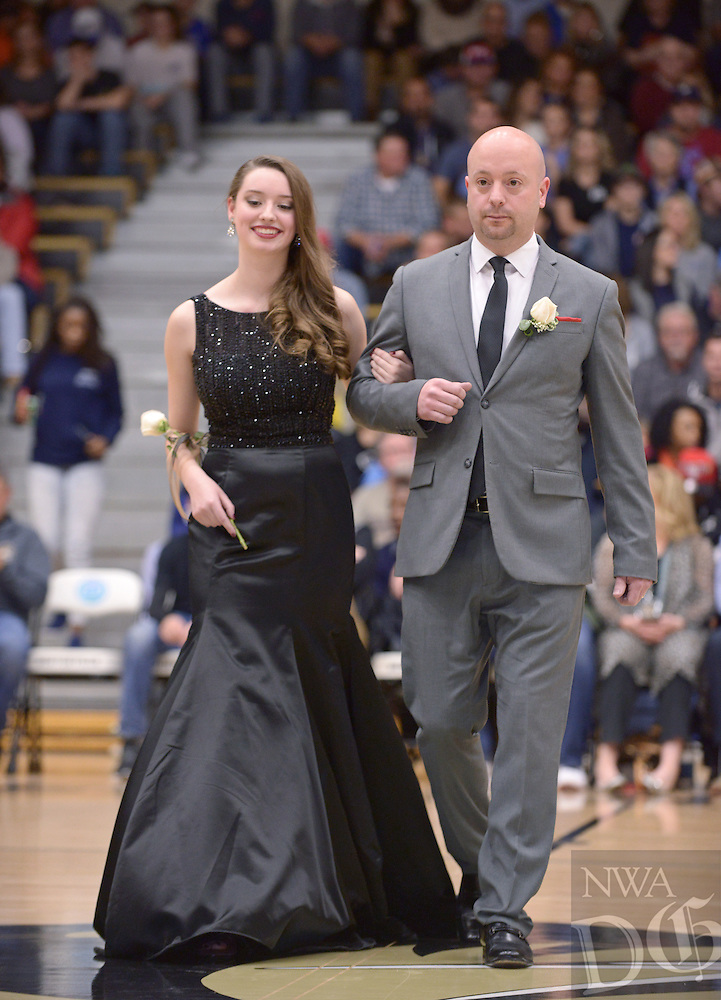 NWA Democrat-Gazette/BEN GOFF @NWABENGOFF<br /> Reagan Hughes takes the floor on Friday Jan. 15, 2016 during Bentonville High's colors day ceremony at halftime in the boys basketball game against Springdale Har-Ber in Bentonville's Tiger Arena.