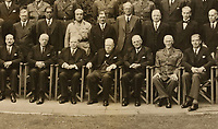BNPS.co.uk (01202 558833)<br /> Pic: ChiswickAuctions/BNPS<br /> <br /> Pictured: Front row (from left), Deputy PM Clement Attlee, Peter Fraser (New Zealand), William Lyon Mackenzie King (Canada), Winston Churchill, John Curtin (Australia), Jan Smuts (South Africa) and Foreign Secretary Anthony Eden.<br /> <br /> A never-before-seen photograph showing Prime Minister Winston Churchill hosting the very first conference of the heads of the Commonwealth at a critical time in the war has come to light.<br /> <br /> The 23ins by 27ins black and white photo was shot in the back garden 10 Downing Street on April 27, 1944, just five weeks before the Allied invasion of Nazi-occupied France.<br /> <br /> The prime ministers of Canada, Australia, New Zealand and South Africa were among the VIPS who attended the historic event.<br /> <br /> The unique photo is coming up for sale at Chiswick Auctions.