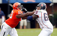 Virginia Cavaliers defensive tackle Will Hill (93) blocks Richmond Spiders offensive linesman Sedale Young (65) during the first half of the NCAA football game Saturday September, 1, 2012 at Scott Stadium in Charlottesville, Va.