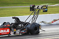 Sep 15, 2018; Mohnton, PA, USA; Contrails come off the rear wing on the dragster of NHRA top fuel driver Terry McMillen during qualifying for the Dodge Nationals at Maple Grove Raceway. Mandatory Credit: Mark J. Rebilas-USA TODAY Sports