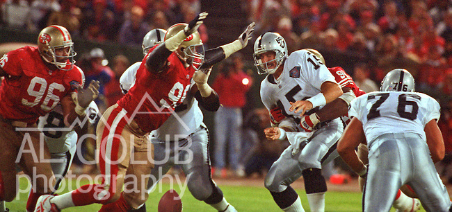 San Francisco 49ers vs. Los Angles Raiders at Candlestick Park Monday, September 5, 1994.  49ers beat Raiders 44-14.  Los Angles Raiders quarterback Jeff Hostetler (15) sacked by 49ers defenders.