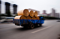 A Truck With Paper Rolls Driving In A Suburban Building Development in Xianyang, China.  © LAN