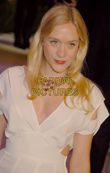 CHLOE SEVIGNY.The 2007 Vanity Fair Oscar Party Hosted by Graydon Carter held at Morton's, West Hollywood, California, USA, 25 February 2007..oscars half length necklace red lipstick  purple hearts white cream dress cut out sides.CAP/ADM/GB.©Gary Boas/AdMedia/Capital Pictures.