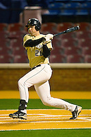 Matt Conway #25 of the Wake Forest Demon Deacons follows through on his swing against the Northwestern Wildcats at Gene Hooks Field on February 26, 2011 in Winston-Salem, North Carolina.  Photo by Brian Westerholt / Four Seam Images