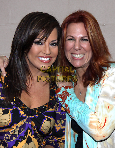 ROBIN MEADE & VICTORIA SHAW .at  a benefit at The Limelight to raise funds for the Abintra Montessori School in Nashville, Nashville, TN, USA, .March 27th, 2010..portrait headshot smiling purple fringe print top yellow .CAP/ADM/DH.©Dan Harr/AdMedia/Capital Pictures.