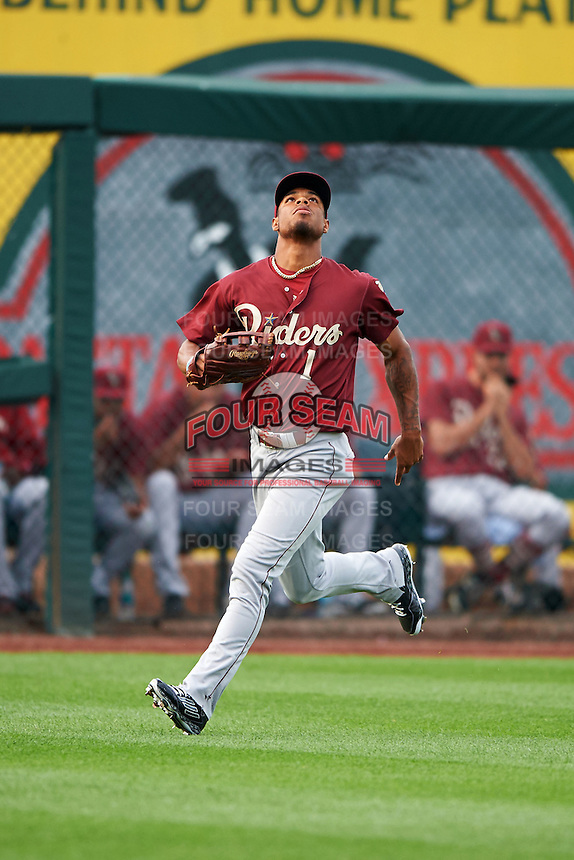 Frisco RoughRiders outfielder Nick Williams (1) tracks down a fly ball during a game against the Springfield Cardinals on June 3, 2015 at Hammons Field in Springfield, Missouri.  Springfield defeated Frisco 7-2.  (Mike Janes/Four Seam Images)