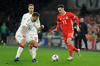 Henrik Dalsgaard of Denmark vies for possession with Tom Lawrence of Wales during the UFEA Nations League B match between Wales and Denmark at The Cardiff City Stadium in Cardiff, Wales, UK. Friday 16 November 2018