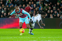 Angelo Ogbonna Obinze of West Ham United and Bafetibis Gomis of Swansea clash during the Barclays Premier League match between Swansea City and West Ham United played at the Liberty Stadium, Swansea  on December 20th 2015