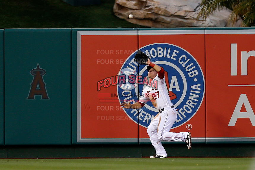 Mike Trout #27 of the Los Angeles Angels catches a fly ball in the outfield during a game against the Chicago White Sox at Angel Stadium on May 17, 2013 in Anaheim, California. (Larry Goren/Four Seam Images)