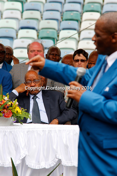 DURBAN - 4 December 2016 - South Africa's President Jacob Zuma looks on as Professor Caesar Nongqunga, the leader of the 4.5 million strong Twelve Apostles Church in Christ speaks at a thanksgiving service in Durban's Moses Mabhida Stadium. Nongqunga later urged church members to deposit their savings intoo the same bank that had earlier in the year given Zuma a loan to pay for the controversial non-security upgrades to his personal residence in Nkandla. Picture: Allied Picture Press/APP