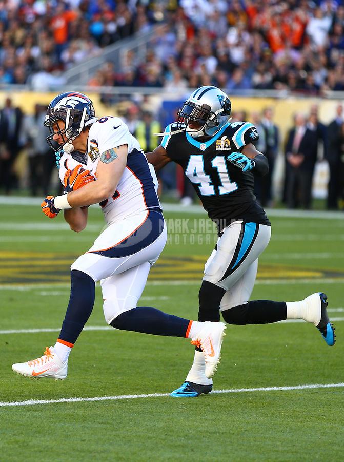 Feb 7, 2016; Santa Clara, CA, USA; Denver Broncos tight end Owen Daniels (81) is tackled by Carolina Panthers safety Roman Harper (41) in Super Bowl 50 at Levi's Stadium. Mandatory Credit: Mark J. Rebilas-USA TODAY Sports