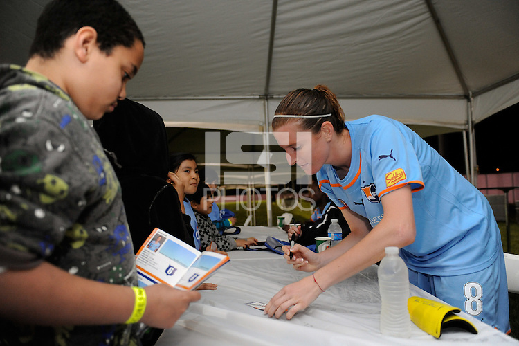 Adriana (8) of Sky Blue FC signs autographs after the game. Sky Blue FC defeated the Atlanta Beat 3-0 during a Women's Professional Soccer (WPS) match at Yurcak Field in Piscataway, NJ, on May 21, 2011.