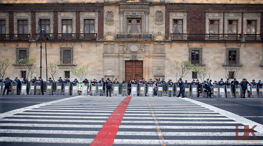 To avoid riots from happening, the Mexican Police line up in front of the Presidential palace in Mexico City.<br /> Mexico City laborers are protesting the government in Mexico City, Mexico. The Mexico City government is laying of more than 40,000 people as the year long Electrical project got done.