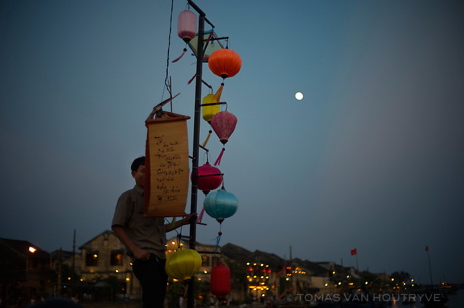 A man adjusts lanterns at a celebration marking the end of Tet, the lunar new year, in Hoi An, Vietnam on 27 February 2010.
