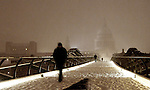 Snow blizzards hit London..Man crosses Millennium Bridge with St Paul's in the background..People struggled home on foot and in taxis and buses....Picture by Gavin Rodgers/ Pixel 07917221968
