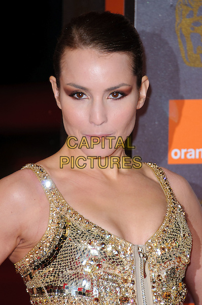 NOOMI RAPACE .2011 Orange British Academy Film Awards (Baftas) at The Royal Opera House, London, England, UK, .February 13th, 2011..arrivals portrait headshot gold sequined sequin zip make-up eyeshadow beauty hair up .CAP/CJ.©Chris Joseph/Capital Pictures.