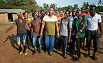 Frido Kinkolenge is coordinator of children's ministries for the United Methodist Church in Liberia. Here he walks with youth at the Brighter Future Children Rescue Center in Buchanan. The center carries out rehabilitation work with ex-combatants and other war-affected children.