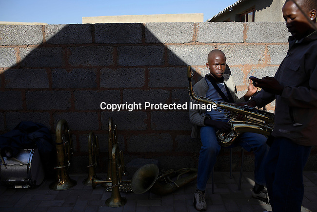 Members of a brass band relaxes while playing at a wedding in Diepkloof, Soweto.