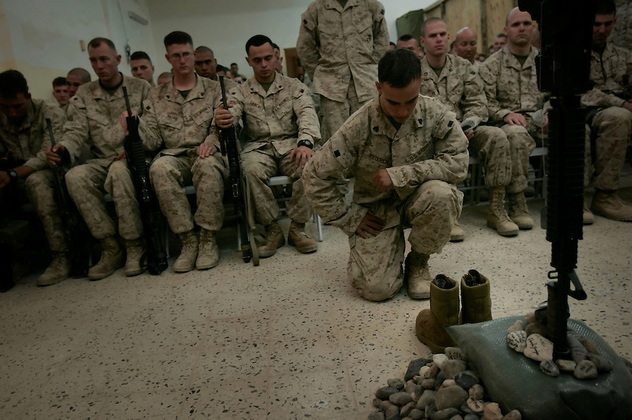 Sgt. Franks Wuterich bows his head in prayer during a memorial service for Lance Corporal Miguel Terrazas killed in action by an IED in Haditha, Iraq on Nov. 19, 2005. The service was held at the company's firm base on Tues. Nov. 29, 2005.