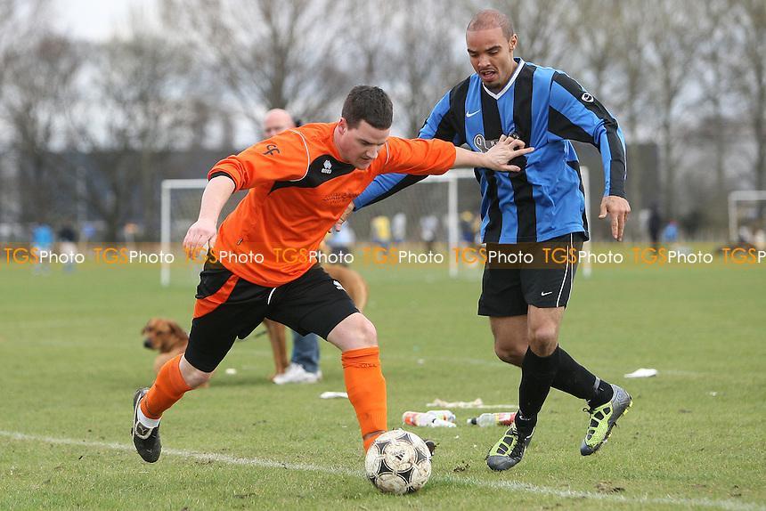 Hackney Borough (blue/black) vs Wharfhampton - Hackney & Leyton Sunday League Alberts Daniels Senior Cup Semi-Final Football at South Marsh, Hackney Marshes, London - 18/03/12 - MANDATORY CREDIT: Gavin Ellis/TGSPHOTO - Self billing applies where appropriate - 0845 094 6026 - contact@tgsphoto.co.uk - NO UNPAID USE.