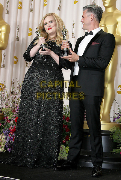 Adele (Adele Laurie Blue Adkins) & Paul Epworth.85th Annual Academy Awards held at the Dolby Theatre at Hollywood & Highland Center, Hollywood, California, USA..February 24th, 2013.pressroom oscars full length trophies winners black dress tuxedo white shirt glasses award trophy winner profile  beads beaded .CAP/ADM.©AdMedia/Capital Pictures.