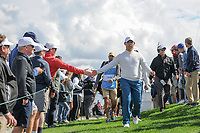 Si Woo Kim (KOR) shakes hands on his way to 4 during round 3 Four-Ball of the 2017 President's Cup, Liberty National Golf Club, Jersey City, New Jersey, USA. 9/30/2017.<br /> Picture: Golffile | Ken Murray<br /> <br /> All photo usage must carry mandatory copyright credit (&copy; Golffile | Ken Murray)