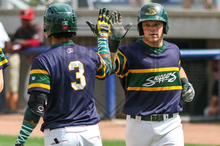 BELOIT - September 2014: Luis Baez (3) and Philip Pohl (12) of the Beloit Snappers during a game against the Wisconsin Timber Rattlers on September 1st, 2014 at Pohlman Field in Beloit, Wisconsin.  (Photo Credit: Brad Krause)