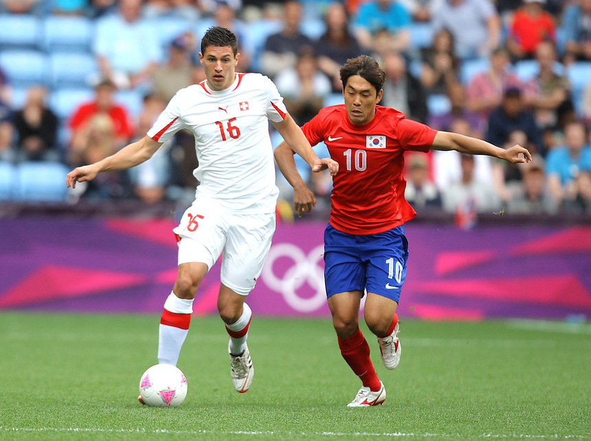 Switzerland's Fabian SCHAER battles with Korea Republic's PARK Chuyoung ..2012 London Olympics - Football - Group B -Korea Republic v Switzerland - Sunday 29th July 2012 - City of Coventry Stadium - Coventry ..