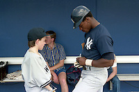 New York Yankees Rickey Henderson signs an autograph during spring training circa 1989 at Ed Smith Stadium in Sarasota, Florida.  (MJA/Four Seam Images)