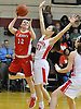 Emily Meyer #12 of St. John the Baptist, left, drives past Kimberly Soriano #31 of Monsignor McClancy during the CHSAA varsity girls basketball Class B state semifinals at Monsignor McClancy High School in East Elmhurst, NY on Friday, Mar. 11, 2016. McClancy won by a score of 63-49.