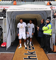 SWANSEA, WALES - FEBRUARY 21: L-R Ashley Williams and Kyle Naughton of Swansea exiting the tunnel prior to the Barclays Premier League match between Swansea City and Manchester United at Liberty Stadium on February 21, 2015 in Swansea, Wales.