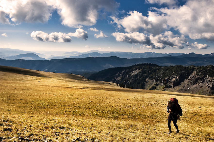 A backpacker hikes along the Gallatin Crest north of Yellowstone National Park.