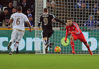 Jamie Vardy of Leicester City (C) is denied yet another goal by Lukasz Fabianski of Swansea (R) during the Barclays Premier League match between Swansea City and Leicester City at the Liberty Stadium, Swansea on December 05 2015