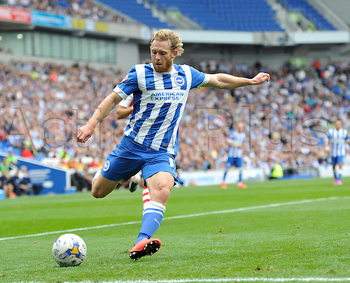 30.08.2014.  Brighton, England. Sky Bet Championship. Brighton and Hove Albion versus Charlton Athletic. Brighton's Craig Mackail-Smith crosses the ball